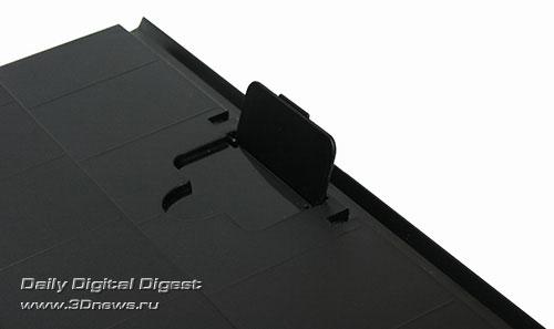 Epson Stylus Office TX600FW. Ограничитель хода бумаги на приемном лотке
