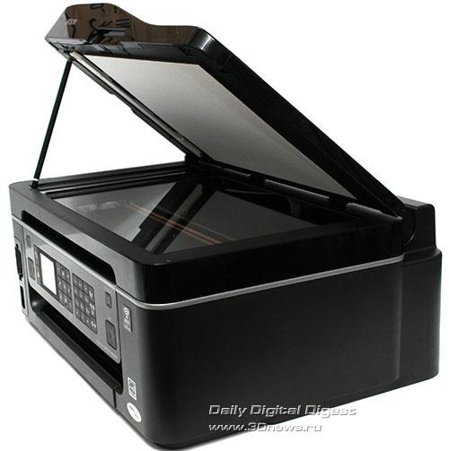 Epson Stylus Office TX600FW. Вид общий с поднятой крышкой сканера