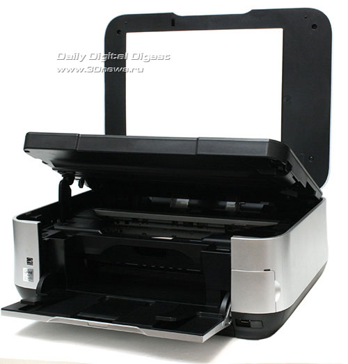 Canon PIXMA MP640. Вид общий. Открыта крышка сканера, поднят сканер и открыт приемный лоток.