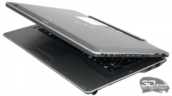 Fujitsu Stylistic Q702, three-quarter view &quot;height =&quot; 335 &quot;width =&quot; 600 &quot;/&gt; </a> </div> <p> The removable keyboard (it&#39;s a docking station or a replicator port, if you like) turned out to be quite massive &#8211; there&#39;s no point in saving on the mass of this component, because if you make it too light, the device will overturn. Therefore, inside, for example, there is a second battery &#8211; and a removable one. Despite the considerable thickness, the rigidity of the case of the docking station is clearly lacking. </p> <p> <span> The working area is finished with a sheet of metal with processing for rough grinding, it is difficult to scratch it. </span> All necessary ports and keys are on the left and right ends of the device: one USB port of the second and third versions, HDMI video output, a card reader for SD cards, and two 3.5 mm audio connectors for headphones and a microphone, respectively. In addition to the I / O ports, on the right edge of the tablet there are control keys and switches (Power and Wi-Fi). From the bottom there is a keyboard connector, a pair of speakers and a SIM card slot hidden by a rubber stopper. </p> <div align=