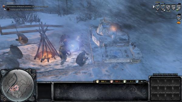 Пока гвардейцы греются у костра, саперы спешно чинят реквизированный немецкий танк