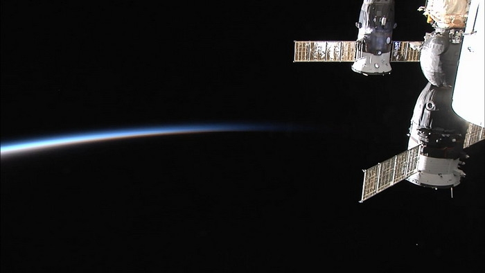 Dawn on the ISS. In the right part of the picture manned spacecraft